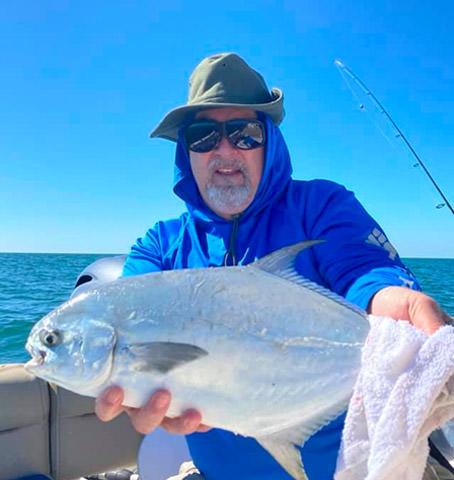 Captain Doug Kelley holding a fish