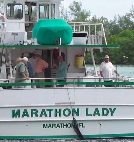 Boat name Marathon Lady printed on the boat's stern