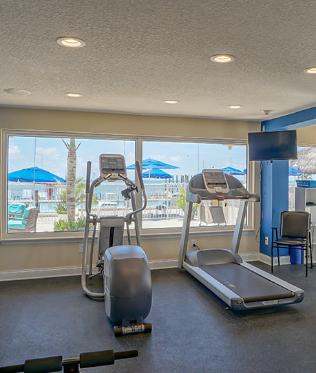 Treadmill and elliptical machine in fitness room