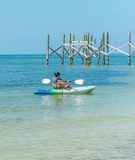 woman kayaking on the beach